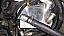 Oil cooler assembly mounted under master cylinder